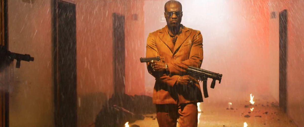 yahya abdul-mateen ii as young morpheus-ish guy firing guns in a hallway in The Matrix Revolutions