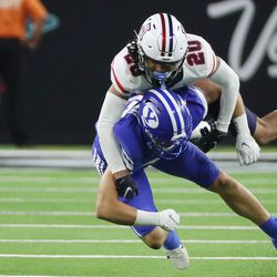 Brigham Young Cougars tight end Dallin Holker (32) has the ball batted away by Arizona Wildcats cornerback Treydan Stukes (20) during the Vegas Kickoff Classic in Las Vegas on Saturday, Sept. 4, 2021. BYU won 24-16.
