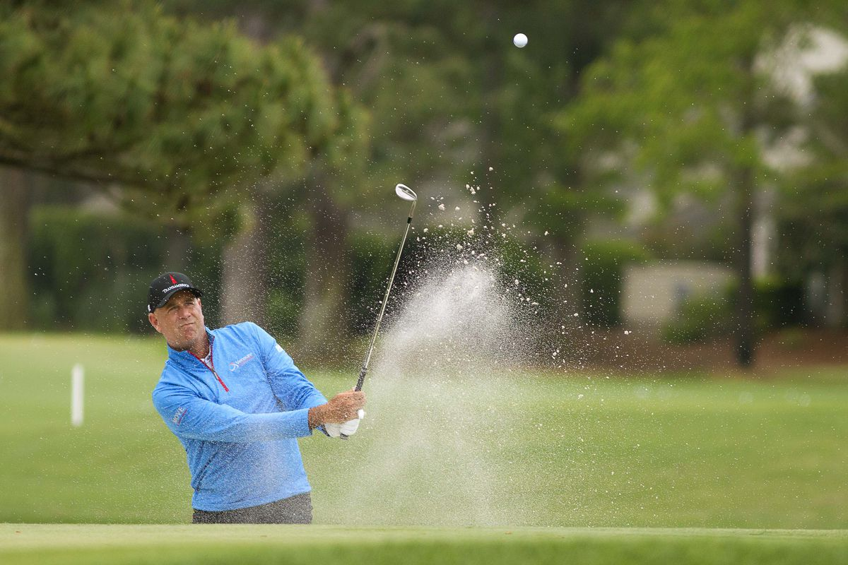 Stewart Cink hits out of the bunker on the ninth hole during the second round of the RBC Heritage golf tournament.