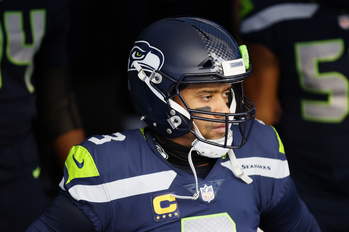 Quarterback Russell Wilson #3 of the Seattle Seahawks leads his team onto the field to start the NFC Wild Card Playoff game against the Los Angeles Rams at Lumen Field on January 09, 2021 in Seattle, Washington.