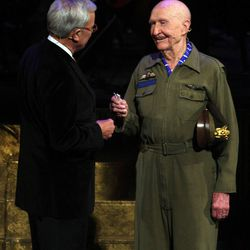 """Tom Brokaw gives Gail Halvorsen, the """"Candy Bomber,"""" two sticks of gum during the Mormon Tabernacle Choir Christmas concert in Salt Lake City, Friday, Dec. 14, 2012."""