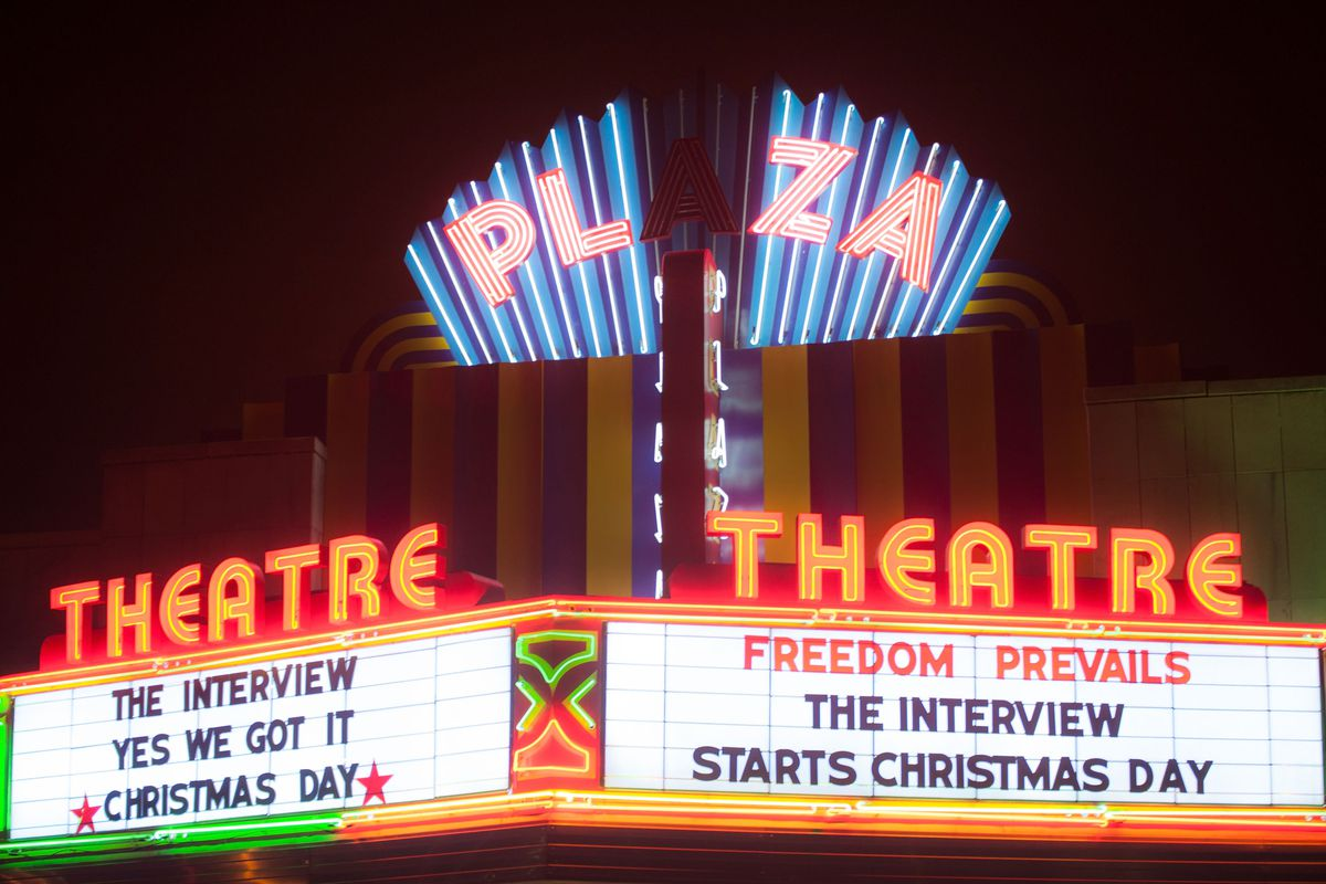 The marquee of the Plaza Theatre in Atlanta shows off screenings of The Interview.
