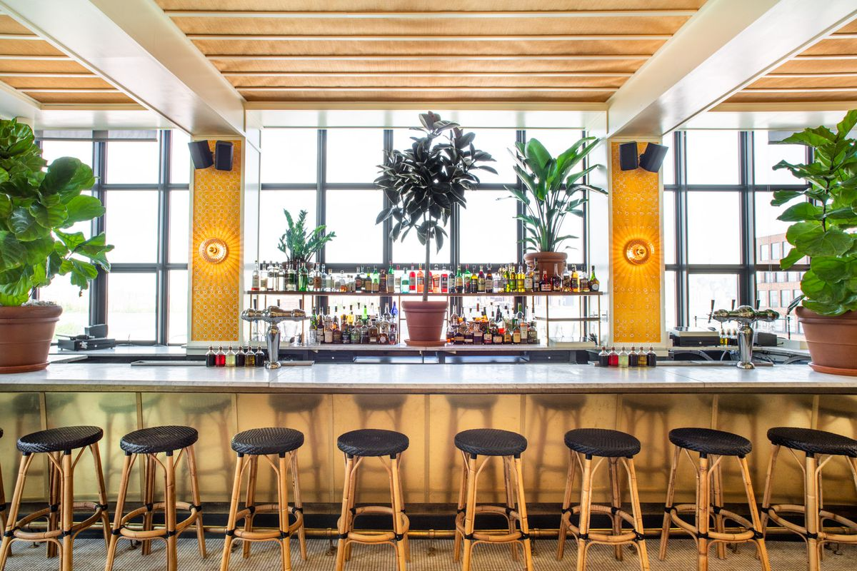 The plant-filled bar at Lemon's at the Wythe Hotel
