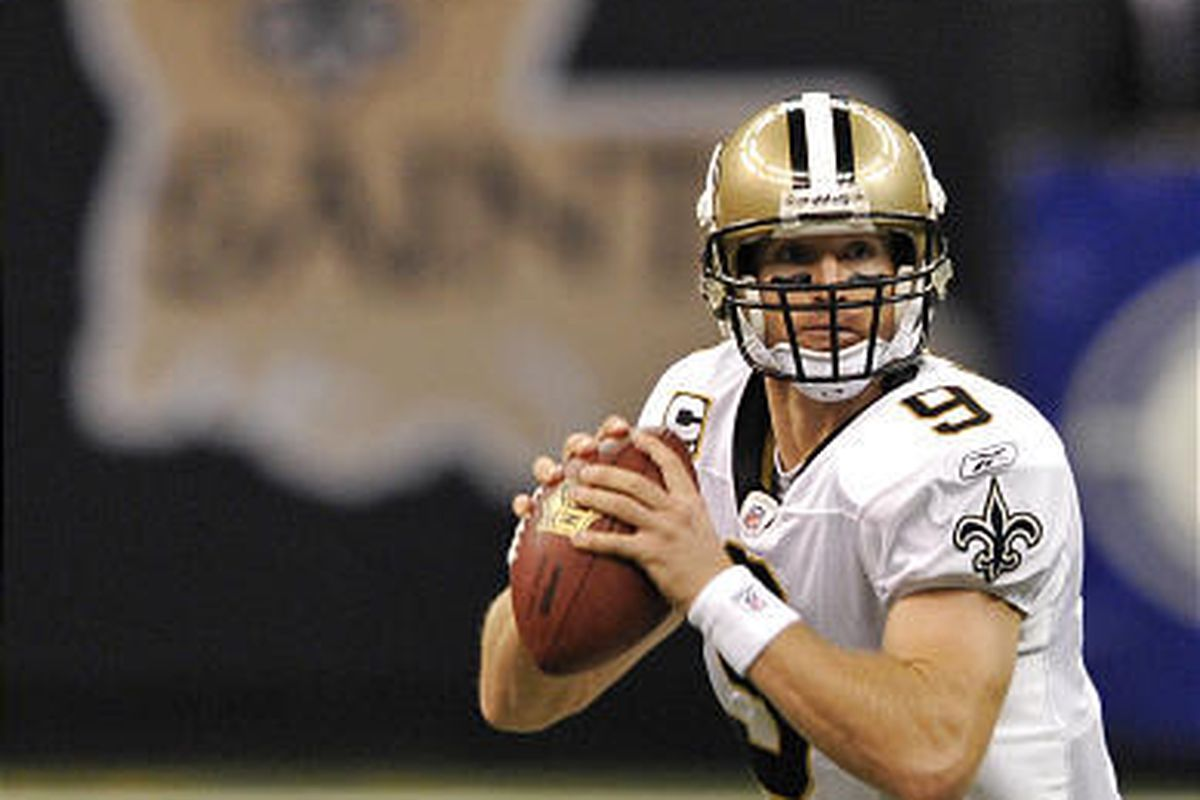 New Orleans Saints quarterback Drew Brees throws a pass during the first half against the Lions.