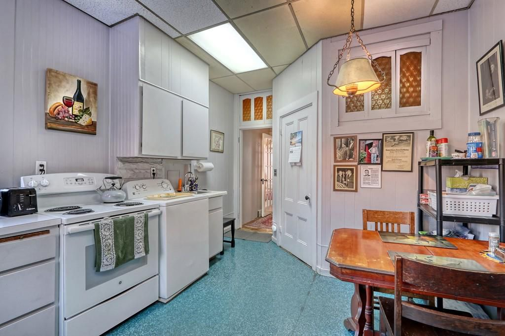 Another angle on the same kitchen, leading down a hallway.