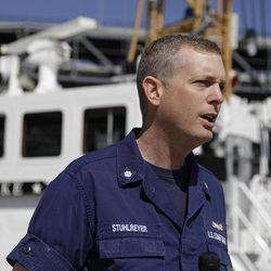 """U.S. Coast Guard Commander Tom Stuhlreyer stands by the cutter Pike and talks about the search for four yacht crew members thrown from their boat on a weekend race, during an interview at the Coast Guard station on Yerba Buena Island in San Francisco, Monday, April 16, 2012.  The search for the missing sailors off Northern California was indefinitely suspended, with the Coast Guard saying the """"window of survivability"""" had passed. The Pike was one of the Coast Guards cutters involved in the search and rescue."""
