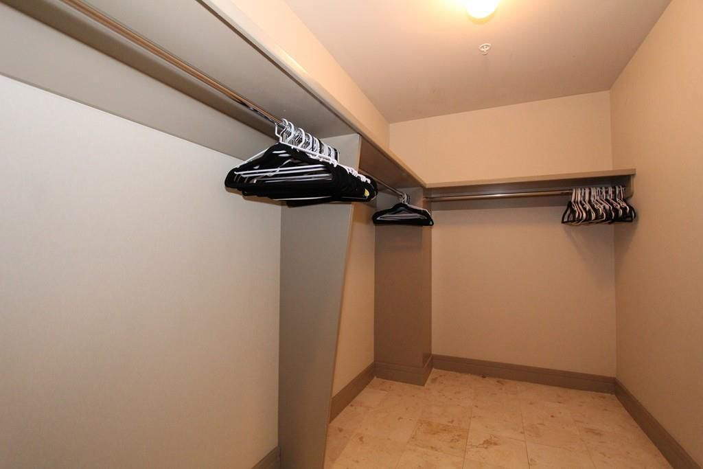 A large, empty walking closet with hangers.