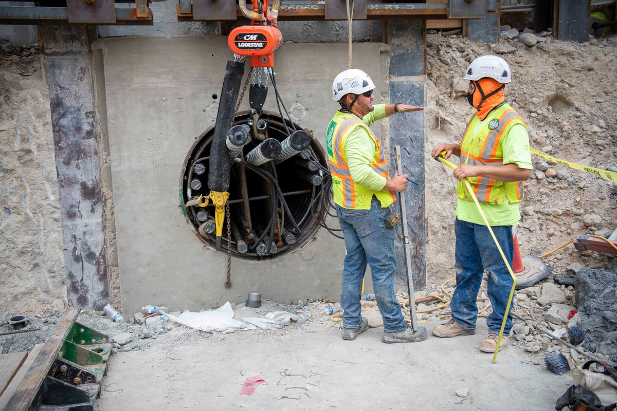 Construction workers fill the new pipes in the foundation with reinforced steel, Salt Lake City, Utah, Sept. 2021.