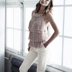 Top with pleated layers, $49.95; bonded trousers, $129