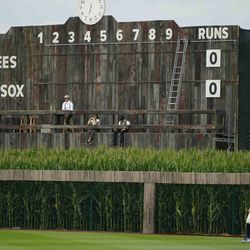 The scoreboard is shown in the outfield during a baseball game between the New York Yankees and Chicago White Sox, Thursday, Aug. 12, 2021 in Dyersville, Iowa. The Yankees and White Sox are playing at a temporary stadium in the middle of a cornfield at the Field of Dreams movie site, the first Major League Baseball game held in Iowa.