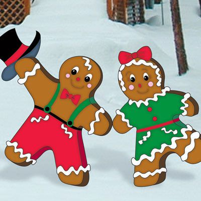 Two wooden gingerbread decorations.
