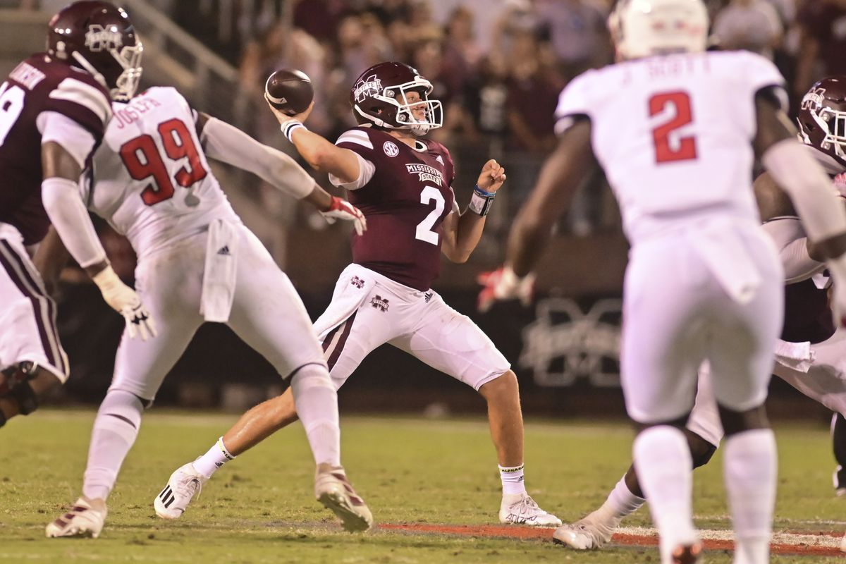Mississippi State Bulldogs quarterback Will Rogers (2) throws against the North Carolina State Wolfpack during the second quarter at Davis Wade Stadium at Scott Field.