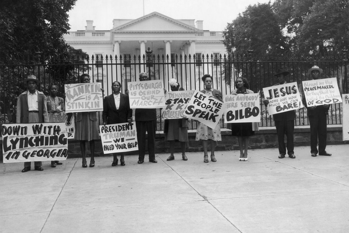 Demonstrators protest lynching in the South.