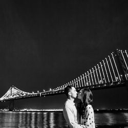 """The Bay Lights is an art installation on the Bay Bridge that will only be on display through to March 5, 2015. Remember it always by capturing its sparkle in your engagement shoot. [Photo from <a href=""""http://www.crispstudios.com/blog/"""">Crisp Studios</a>]"""