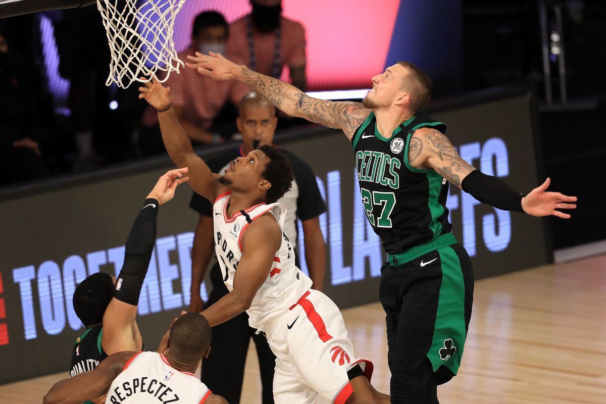 Kyle Lowry of the Toronto Raptors and Daniel Theis of the Boston Celtics fight for a rebound during the fourth quarter in Game Two of the Eastern Conference Second Round during the 2020 NBA Playoffs at The Field House at ESPN Wide World Of Sports Complex on September 01, 2020 in Lake Buena Vista, Florida.
