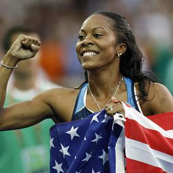 United States' Sanya Richards celebrates winning the gold in the Women's 400m final during the World Athletics Championships in Berlin on Tuesday.