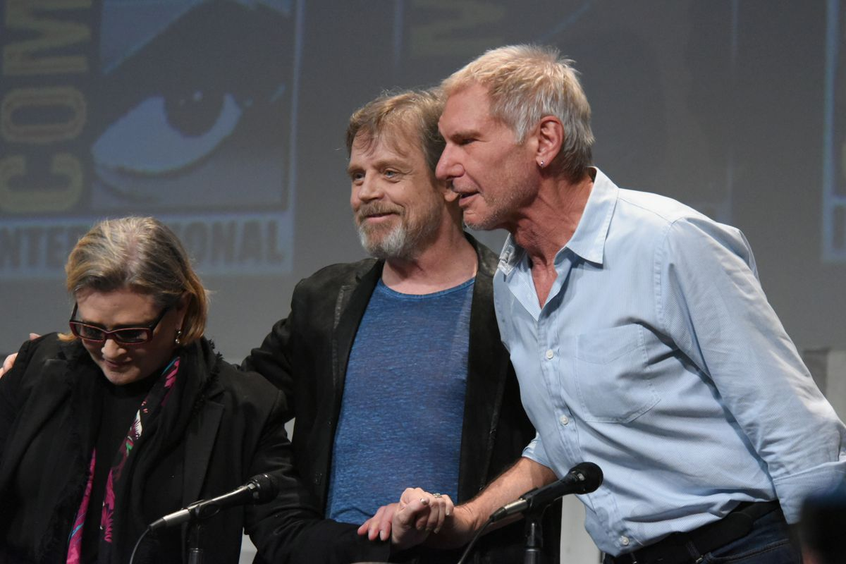 """Carrie Fisher, from left, Mark Hamill, and Harrison Ford attend Lucasfilm's """"Star Wars: The Force Awakens"""" panel on day 2 of Comic-Con International on Friday, July 10, 2015, in San Diego, Calif."""