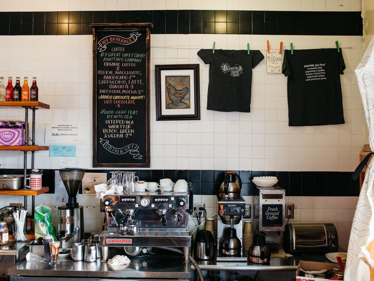 The coffee and espresso counter inside Brooklyn Street Local has swag hanging on the walls.