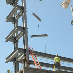 1:54 p.m. Steel girders being lowered into the right-field video board structure -