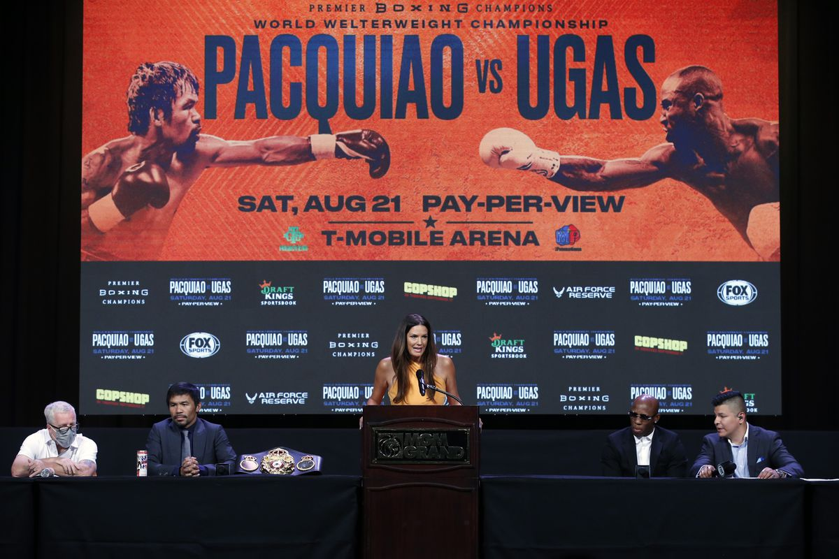 Fox sports reporter Heidi Androl (C) hosts a news conference with Manny Pacquiao and WBA welterweight champion Yordenis Ugas at MGM Grand Garden Arena on August 18, 2021 in Las Vegas, Nevada.