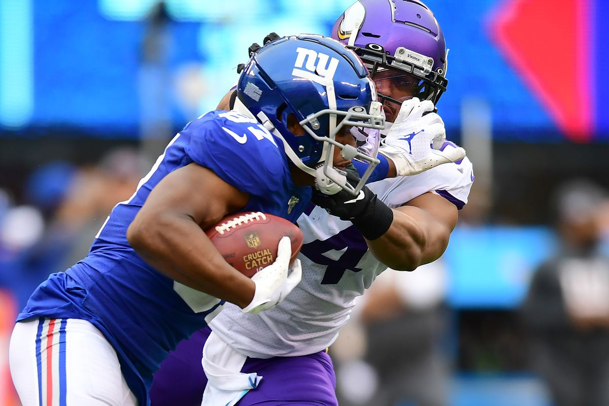 Sterling Shepard of the New York Giants stiff arms Eric Kendricks of the Minnesota Vikings during their game at MetLife Stadium on October 06, 2019 in East Rutherford, New Jersey.