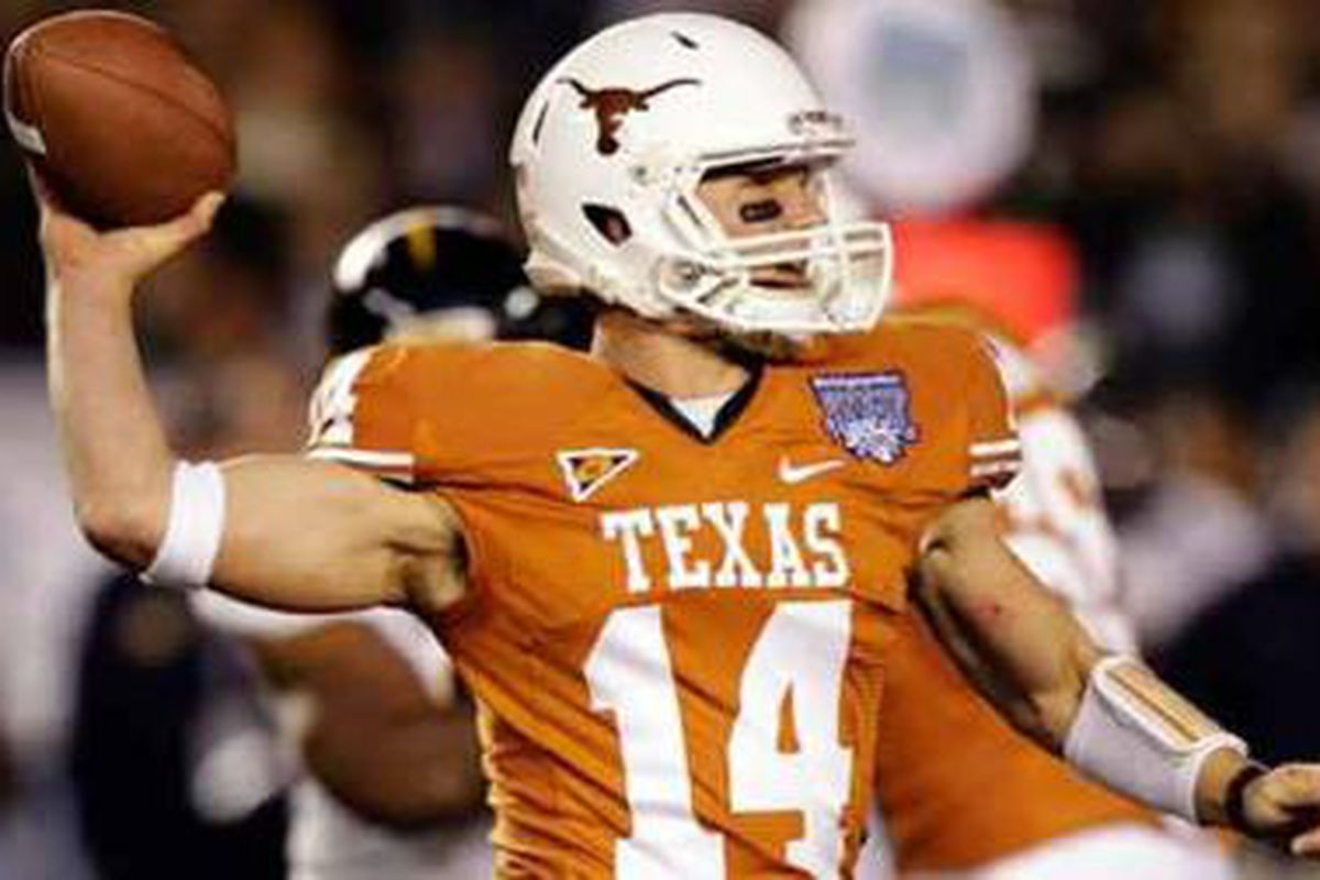 Texas freshman quarterback David Ash led the Longhorns in a turnover free performance that produced a 21-10 win over California in the Bridgeport Holiday Bowl. <em>(AP Photo)</em>
