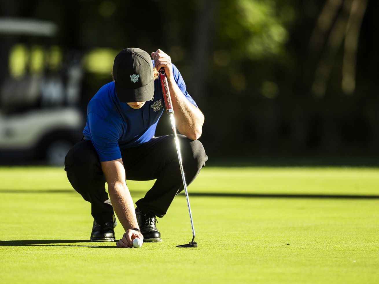 File: Carson Lundell places the ball for a putt. He and the Cougars are ranked in the top 10 for the first time this year. Lundell fired a 71 Tuesday at the U.S. Men's Amateur, after shooting a 69 on Monday, to finish at 3-under-par 140 in a tie for 16th place in medal play.