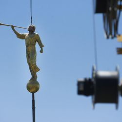 The Angel Moroni statue gets replaced on the Bountiful Utah Temple in Bountiful, Wednesday, June 1, 2016. Lightning struck the statue on May 22.