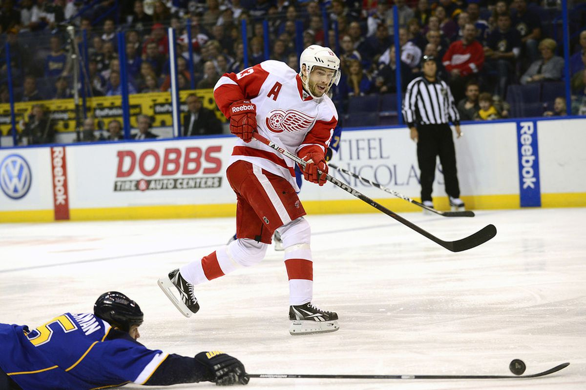 Mar 4, 2012; St. Louis, MO, USA; St. Louis Blues defenseman Barret Jackman (5) deflects a pass by Detroit Red Wings center Pavel Datsyuk (13) during the first period at the Scottrade Center. Mandatory Credit: Scott Rovak-US PRESSWIRE