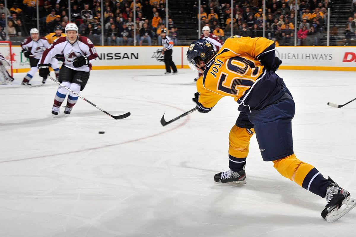 NASHVILLE, TN - JANUARY 12:  Roman Josi #59 of the Nashville Predators takes a shot against the Colorado Avalanche at the Bridgestone Arena on January 12, 2012 in Nashville, Tennessee.  (Photo by Frederick Breedon/Getty Images)