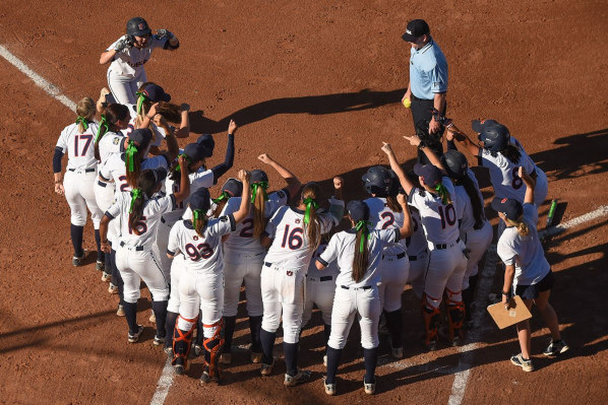 Carlee Wallace is welcomed home after hitting a 3-run home run in the 1st inning.