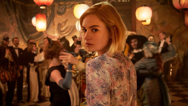 Lily James as Mrs. de Winter looking over her shoulder in Rebecca