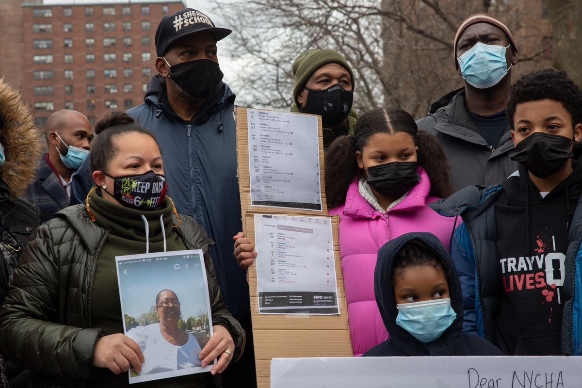 Eleanor Dowe's family hold a list of complaints she made to NYCHA about elevators at The Bronx's Webster Houses, Jan. 5, 2020.