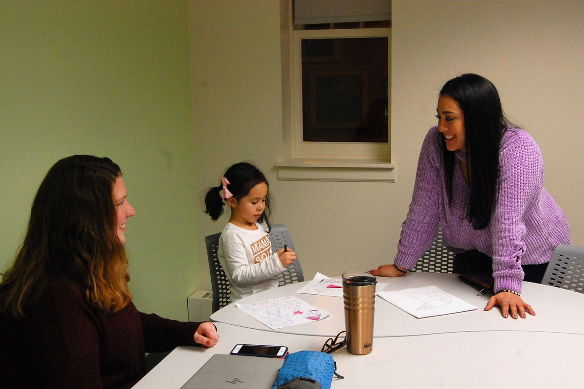 In December, Afrodita Salgado (right) brought her 5-year-old daughter, Amelia, to meet with her coach, Angela Crawford Neven, in a Chicago public library as part of a new online college program.