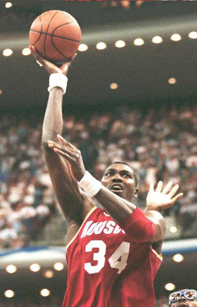Houston Rockets Hakeem Olajuwon scores two of his