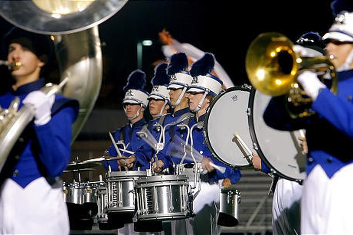 The Pleasant Grove High School marching band competes in the 36th annual Davis Cup High School Marching Band Competition at Davis High School in Kaysville on Tuesday. Among the featured performers were marching bands from Idaho, Provo, Grantsville, Timpan