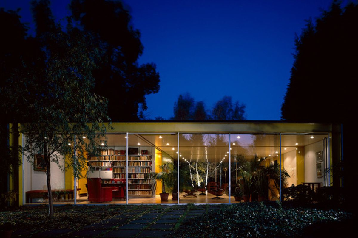 Exterior shot of single story glass house.