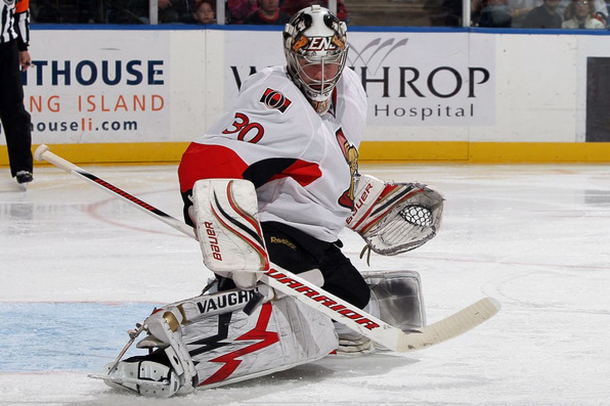 UNIONDALE, NY - APRIL 03:  Brian Elliott #30 of the Ottawa Senators makes a save against the New York Islanders on April 3, 2010 at Nassau Coliseum in Uniondale, New York.  (Photo by Jim McIsaac/Getty Images)