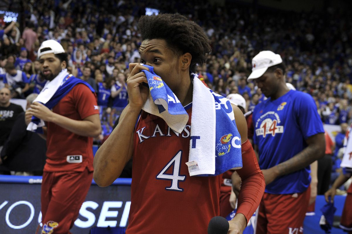 Sluggish Jayhawks advance to championship over bruised Wildcats