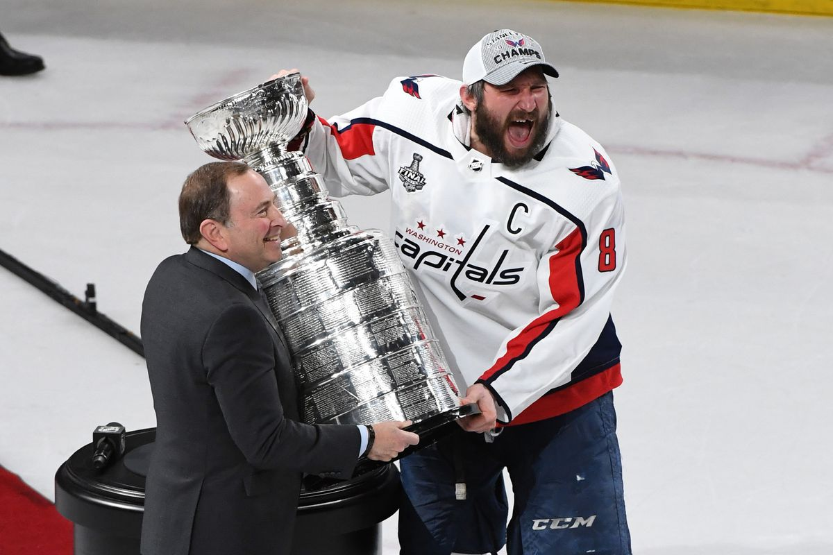 NHL Commissioner Gary Bettman presents Alex Ovechkin of the Washington Capitals with the Stanley Cup after the Capitals defeated the Vegas Golden Knights 4-3 in Game Five of the 2018 NHL Stanley Cup Final at T-Mobile Arena on June 7, 2018 in Las Vegas, Nevada.