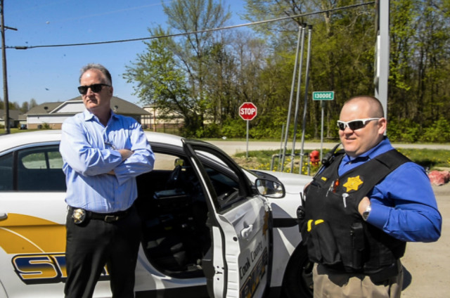 Greg Shields (left), executive director of community corrections for Cook County Sheriff Tom Dart, with John Webb, in Hopkins Park.   Tyler LaRiviere / Sun-Times