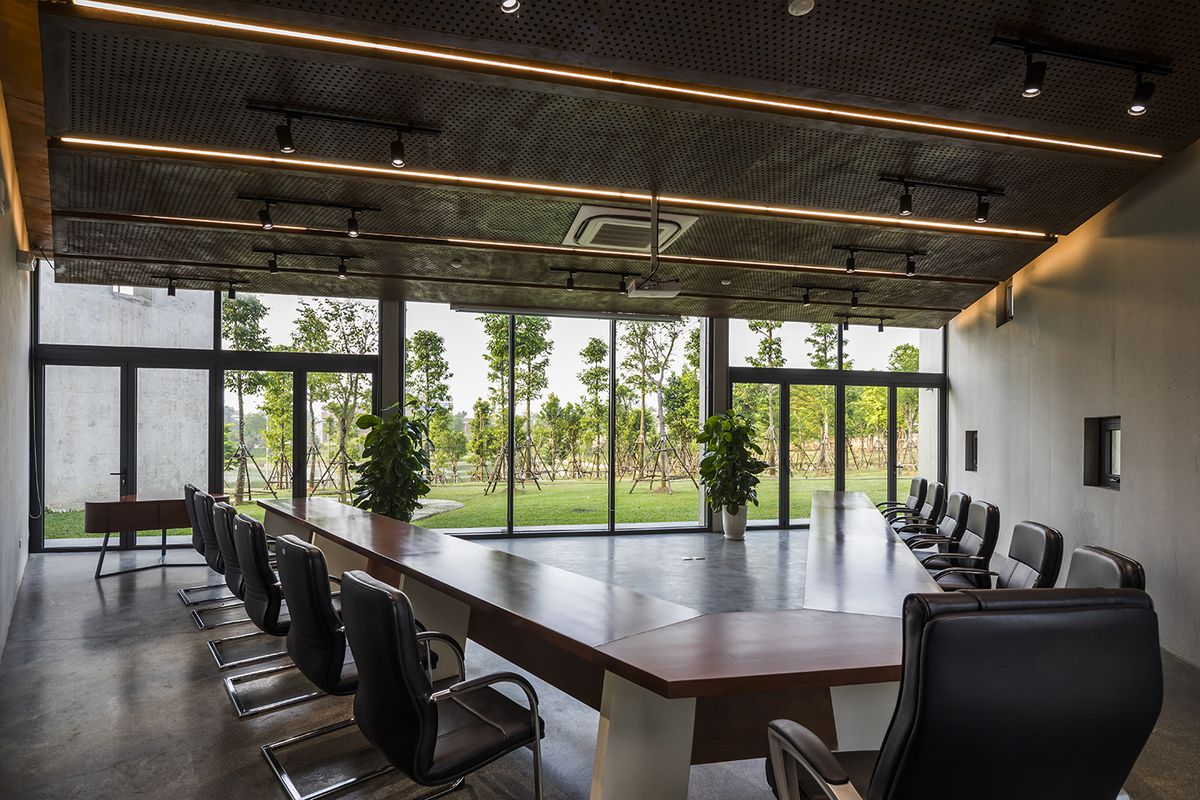 Meeting room with large wooden table and big windows