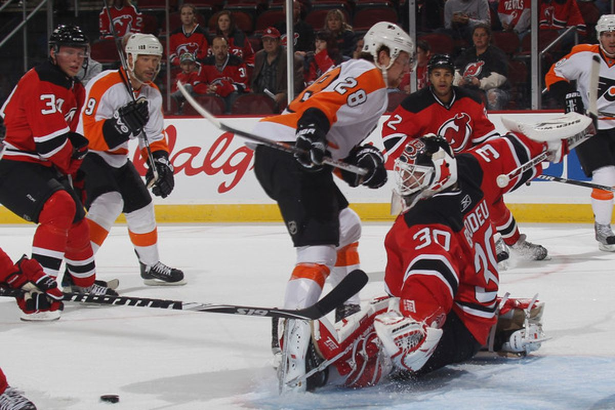 NEWARK NJ - SEPTEMBER 28: Claude Giroux #28 of the Philadelphia Flyers is stopped by Martin Brodeur #30 of the New Jersey Devils at the Prudential Center on September 28 2010 in Newark New Jersey. (Photo by Bruce Bennett/Getty Images)