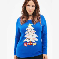 """<strong>Forever21</strong> Holiday Bell & Tree Sweater, <a href=""""http://www.forever21.com/Product/Product.aspx?br=PLUS&category=plus_size-main&productid=2000134684"""">$22.90</a>"""