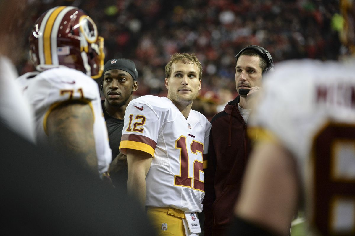Washington quarterback Robert Griffin III, QB Kirk Cousins, and offensive coordinator Kyle Shanahan watch the replay of his first quarter interception during the game between Washington and the Atlanta Falcons at the Georgia Dome on Sunday, December 15, 2013.