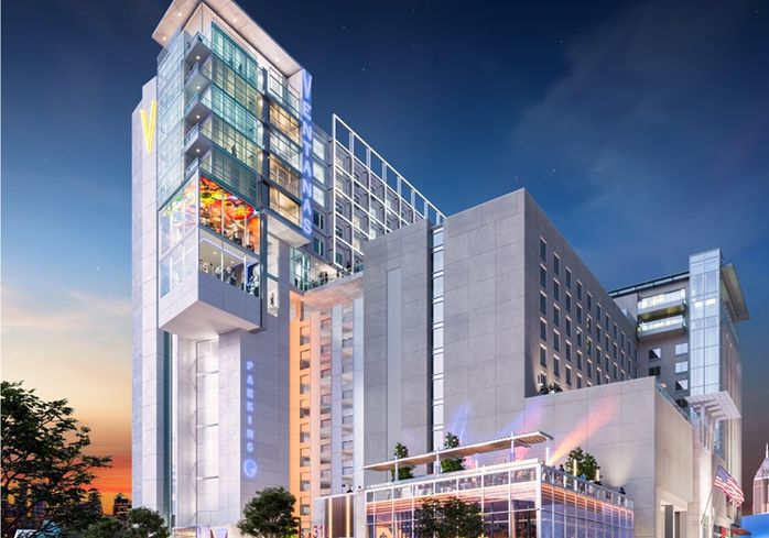 Another view of the rendering shows the new hotel addition, flush with glassy, geometric accents, towering over the rest of the complex below.