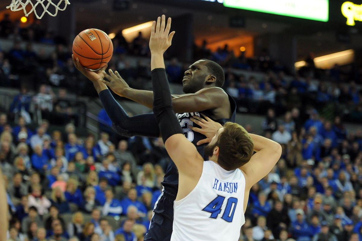 Daniel Ochefu attacks the rim for two of his 19 points.