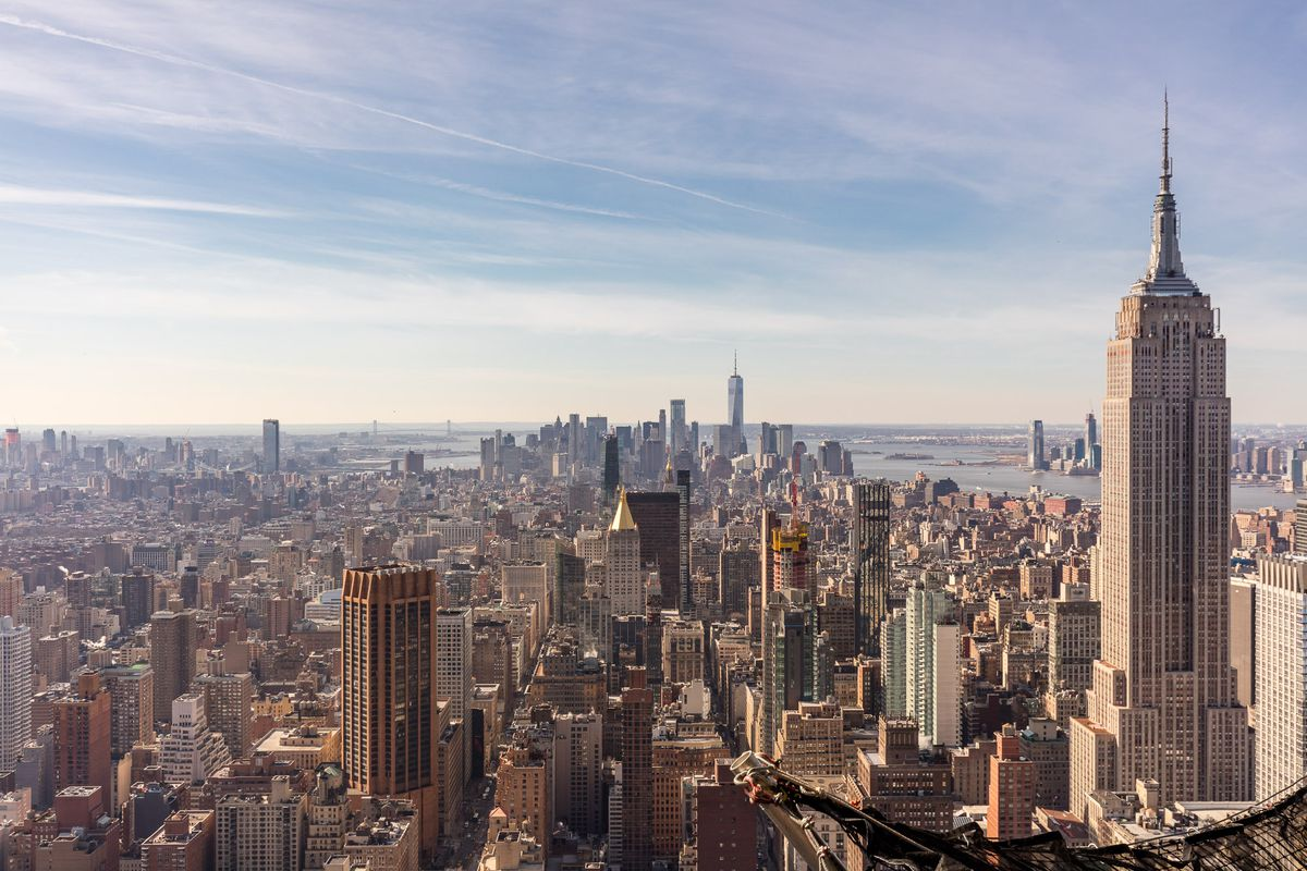 The New York City skyline at daytime, with the Empire State Building in the foreground.
