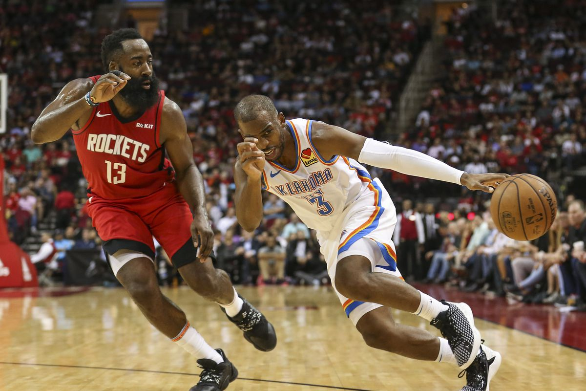 Oklahoma City Thunder guard Chris Paul loses control of the ball as Houston Rockets guard James Harden defends on a play during the third quarter at Toyota Center.