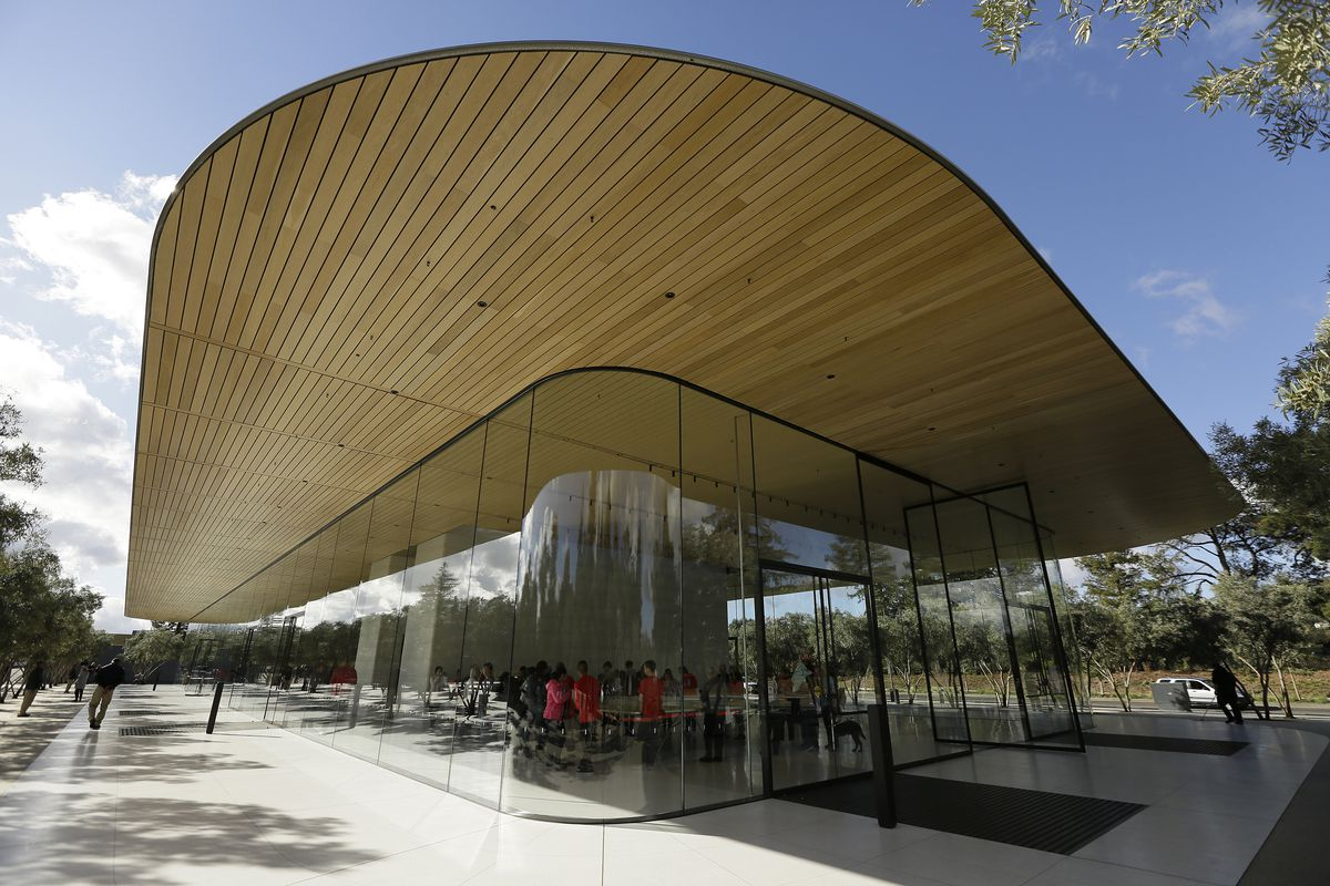 Shown is an exterior view of the Apple Park Visitor Center during its grand opening Friday, Nov. 17, 2017, in Cupertino, Calif. (AP Photo/Eric Risberg)